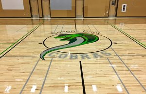 Photo of the hardwood gym floor Titan Sport Systems re-installed for College Park school in Lloydminster, Alberta