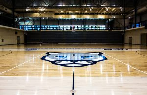 Photo of the hardwood gym floor Titan Sport Systems renovated for Mt. Royal University in Calgary