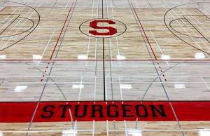 Photo of the hardwood gym floor Titan Sport Systems installed for Sturgeon Composite High School in Namao, Alberta