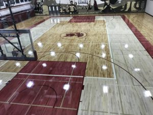 Photo of the amazing hardwood gym floors Titan Sport Systems installed for Archbishop O'Leary Composite High School in Edmonton