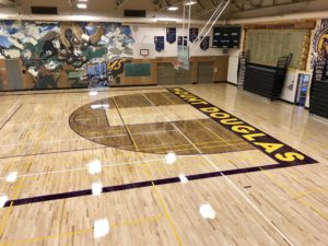 Photo of the hardwood gym floor Titan Sport Systems renovated and installed for Mt Douglas Secondary School in Victoria, BC