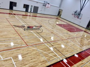 Photo of the hardwood gym floor Titan Sport Systems installed for Ashmont School in Ashmont, Alberta