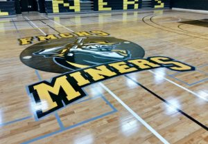 Photo of the hardwood gym floor Titan Sport Systems refinished for Fort McMurray High School