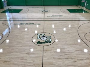 Photo of the beautiful hardwood gym floor Titan Sport Systems installed for the University of Saskatchewan's Belscher Place