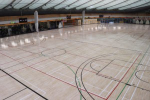 Photo of the large hardwood gym floors Titan Sport Systems refinished for Repsol Sport Centre in Calgary